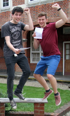 Boys jumping for joy after exam results